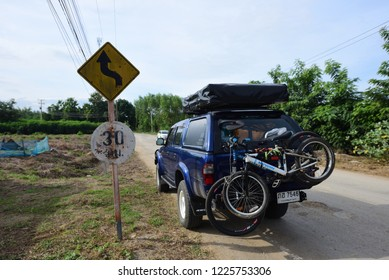 LOEI, THAILAND - 20 October 2018: Toyota Hilux 4x4 Camping car with a roof top tent and bicycles,Morning time on road at Chiang Khan, Loei of Thailand on 20 October 2018 at Chiang Khan, Loei, Thailand