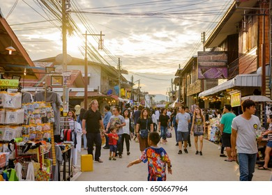 LOEI, THAILAND - DECEMBER 04, 2016: A lot of tourists at Chiang Khan walking Street in Loei district, Thailand. This walking street is on the Chai Khong Rd. alongside the Mekong River.