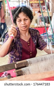 LOEI, THAILAND - FEBRUARY 9, 2014: unidentified woman weave in Loei Red Cross festival.