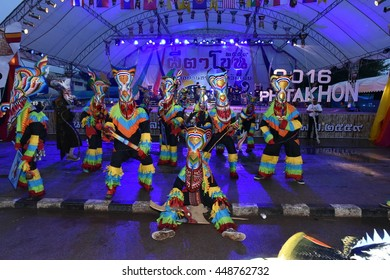 "Loei, Thailand - Jul 6, 2016 : People are dressing with colorful clothes and put the hand made mask which made from wood or threshing bamboo in ghost mask festival or ""Pi Ta Khon"""