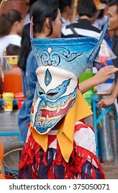 LOEI, THAILAND - July 11,2013: Phi Ta Khon Festival (Traditional ghost mask festival ) Young people (Unidentified) dress in spirit and wear a mask, sing and dance.