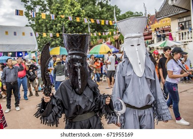 Loei, Thailand -  July 25 2017:Young people (Unidentified) dress in spirit and wear a mask, sing and dance parade along the road in DanSai distric Loei province Thailand. Parade ends at Wat Pone Chai