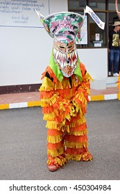 LOEI, THAILAND - July 7, 2016 : Phi Ta Khon Festival ( Traditional ghost mask festival ) Young people dress in spirit and wear a mask, sing and dance.