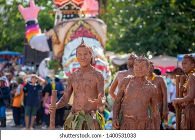 Loei, Thailand - June 16,2018 : Ghost Festival (Phi Ta Khon) People are enjoy dressing with colorful clothes and wear a handmade mask. Parade of Phi Ta Khon (Ghost Festival) dace at street, Loei.