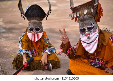 LOEI, THAILAND - June 16,2018: People are Sing and dance with ghost mask at Phi Ta Khon Festival (Traditional ghost mask festival ).They enjoy dressing with colorful clothes made from wood handmade.