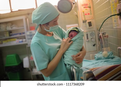 Loei, Thailand, June - 21, 2018 : Nurse takes care for a littel baby in The Obstetrics and Gynecology Hospital