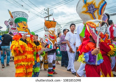 Loei, Thailand - June, 25, 2017 : Ghost Festival (Phi Ta Khon) People are enjoy dressing with colorful clothes and wear a handmade mask. Parade of Phi Ta Khon (Ghost Festival) dace at street, Loei.
