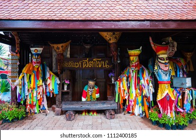 Loei, Thailand - June, 25, 2017 : Ghost Festival (Phi Ta Khon) The exhibition of Phi Ta Khon at Phi Ta Khon Museum. There're collection of colorful clothes and wear a handmade mask.
