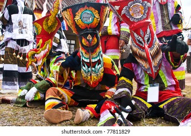 LOEI, THAILAND - JUNE 25: Phi Ta Khon Festival on June 25, 2009 in Loei, Thailand. Young people dress in spirit and wear a mask, sing and dance