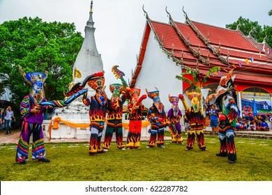 LOEI, THAILAND - JUNE 27, Thai northeastern traditional Phi Ta Khon ghost mask dancer with wooden fake penis in Phi Ta Khon festival parade on June 27, 2015 in Dansai of Loei, Thailand