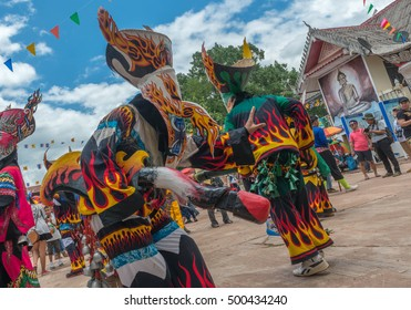 LOEI, THAILAND - June 27,2015: People are Sing and dance with ghost mask at Phi Ta Khon Festival (Traditional ghost mask festival ).They enjoy dressing with colorful clothes made from wood handmade.