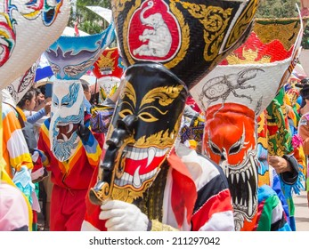 LOEI, THAILAND - JUNE 28, 2014 : Unidentified colorful ghost mask in Phi Ta Khon Festival on June 28, 2014, Loei Province, Thailand
