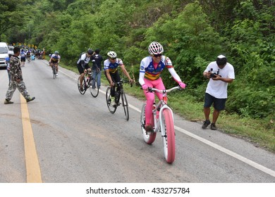 "LOEI, THAILAND June 5,2016:People ride bicycles in ""Tour of Isan Loei Claassic 2?�,  the road bicycle race through Loei  province in Thailand"