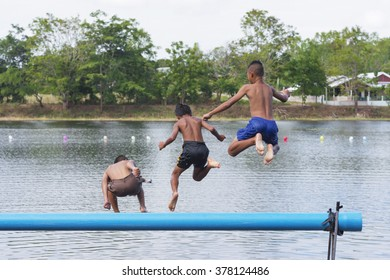Loei , Thailand - November, 24, 2015: Group of happy boys playing in the pool to prepare for boxing in the water (Muay Thaley).