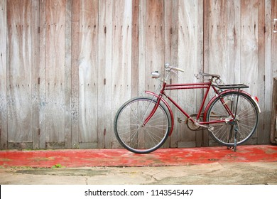 LOEI, THAILAND - OCTOBER 02, 2010: Vintage bycicle near old house at countryside in Thailand