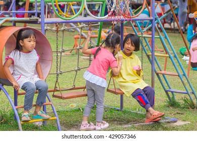 LOEI, THAILAND-APRIL 26 2015: Thai kids at playground park.
