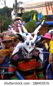 """LOEI ,THAILAND-JUNE 26: Ghost Festival (Phi Ta Khon) is a type of masked procession celebrated on Buddhist merit- making holiday known in Thai as""""Boon Pra Wate"""" at Loei province,JUNE 26,2012"""