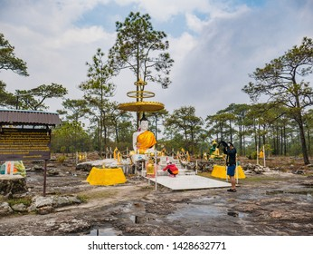 Loei/Thailand-17 Feb 2019:Buddha statue and Unacquainted people  on LanPresrinakarin on top of Phu Kradueng mountain  in Loei City Thailand.Phu Kradueng national park the famous Travel destination