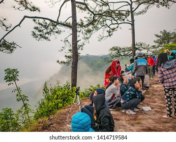 Loei/Thailand-17 Feb 2019:Unacquainted Tourist waiting for sunrise in early morning at Phu Kradueng mountain national park in Loei City Thailand.Phu Kradueng mountain national park