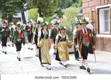 Lofer, Austria - August 13, 2017: A traditional costume parade during summer festivities in a small town called Lofer in Austria
