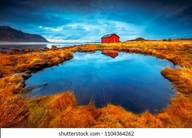 Lofoten islands, amazing landscape, beautiful view on little lake and house near it, exotic travel to Norway