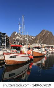 HENNINGSVÆR, LOFOTEN ISLANDS /           NORWAY - MAY 19 2019:  View on the boats which located in the port of Henningsvær, Norway