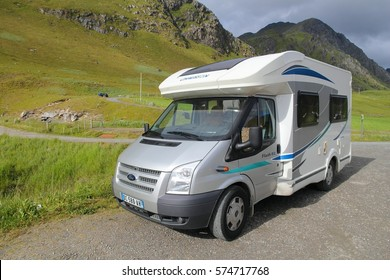 LOFOTEN, NORWAY - JULY 19, 2015: Ford motorhome van in Lofoten islands, Norway. Norway had almost 5 million foreign visitors in 2011.