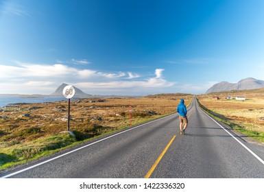 Lofoten, Norway - June 2019 - man on the Lofoten road