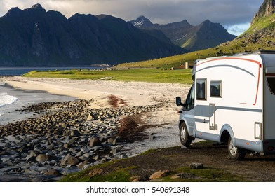 LOFOTEN, NORWAY - JUNE 29, 2015: Holiday trip in motorhome on June 29, 2015. Caravan car on coast. Beautiful nature Norway mountains landscape.