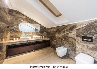 Loft apartment bathroom, marble washbasins and toilet
