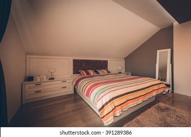Loft apartment interior with double bed