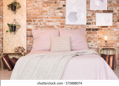 Loft bedroom with double bed and dusty pink bedding