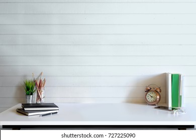 Loft desk work space with marble table, office supplies, documents, notebook and craft tools, mock up desk space concept.