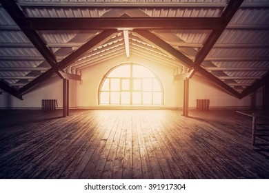 Loft Interior design. Sun rays from big arch window, wooden floor