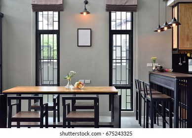 The Loft kitchen has a dining table adorned with orange lamps.