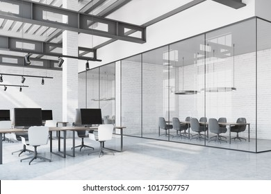 Loft office interior with a white table, white brick walls, loft windows and rows of computer tables with black screens. A meeting room. 3d rendering mock up