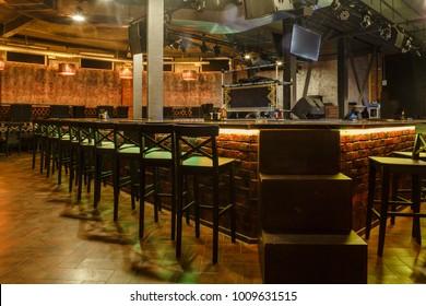 Loft style decorated restaurant-bar interior photo