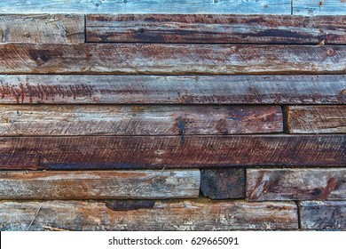 loft style hard wood wall made from old rail roads. Log of wood.