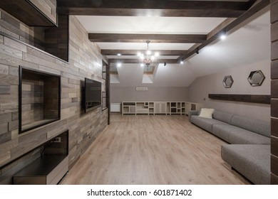 Loft style living room with sofa, TV, tv desk