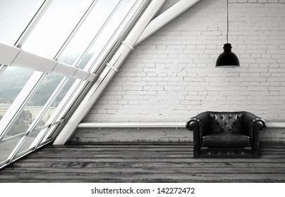 loft with window and black leather chair