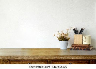 Loft wood desk with vintage books, coffee mug and flower. Workspace and copy space.