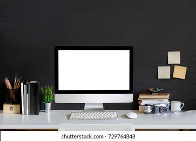 Loft workspace concept. Mock up white screen modern desktop computer and books, minimal stuff on desk.