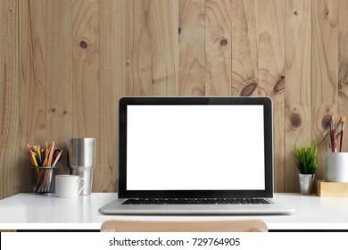 Loft workspace concept. Mock up white screen laptop computer and books, minimal stuff on desk.