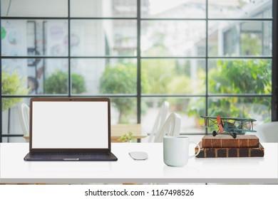 Loft workspace with mockup laptop on desk