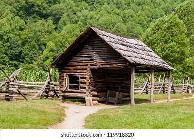 Log building  on a working farm in the mountains