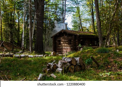 log cabin in autumn forest