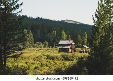 A log cabin in the hunting field, Siberia, Altai. Two-storey house. recreation in the Altai mountains
