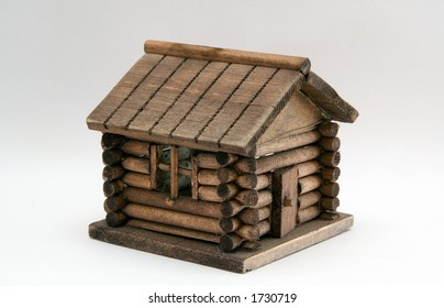 A log cabin is isolated on a white background.