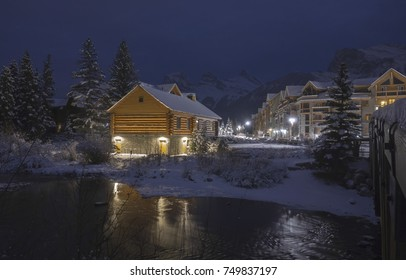 Log Cabin Night Lights in Spring Creek Mountain Village Residential Condo Building Complex near Canmore City Center in Alberta Foothills