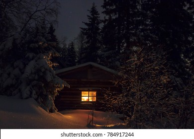 Log cabin in the snow-covered forest